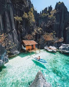 Now how about this waterfront vacation home! Would you live here? We love this little ocean hut perched into the rock formations of Palawan, in the Philippines. Photo by Vacation Places, Dream Vacations, Vacation Spots, Honeymoon Places, Beach Vacations, Beach Travel, Asia Travel, Vacation Trips, The Places Youll Go