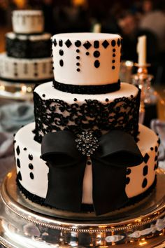 Black lace and gem three tier cake