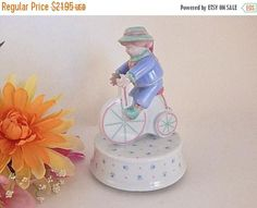 Boy Riding Bike Penny Farthing Bicycle Porcelain Figurine Wind