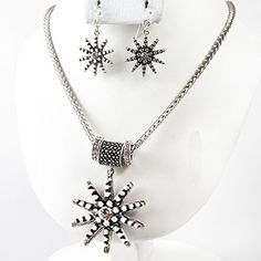 """Chunky 3.3"""" long boot spur charm silver tone necklace set     * If you need a necklace extender I have them for sale in my store.*          NECKLACE: 18"""" + ext      Hook Earrings           COLOR: silver tone $21.99"""