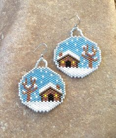 These earrings are beautiful in contrasting colors. They are light weight. Made out of glass Delica beads with silver french hooks. They are 2 long with french hooks, and 1 1/4 wide. The stitch is Peyote Stitch.  I love the roundness of the earrings. People tend to notice them more. Its not a traditional shape for beaded earrings.  They would make a great gift or for yourself. They are very outstanding.  Thank you for looking and have a great day
