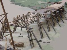 Before starting bridge construction, the Romans built a crane on a raft and floated it out into the river. You can see the framework of this apparatus on the left