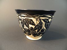 Cherry Bowl    Cobalt floral designs carved into white clay.