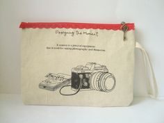 Wristlet in Japanese Linen with Camera Print & Antique Key Zip Closure. $16.00, via Etsy.
