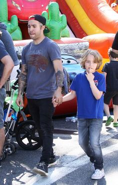 Pete Wentz and Megan Camper take his boys Bronx and Saint to the farmers market on April 3, 2016