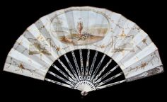 Origin: Holland Date: ca. 1785. This fan is made of beautifully carved and pierced bone and/or ivory sticks and a single handpainted vellum leaf mounted à l'anglaise. The sticks are silvered gilded and show musical instruments and cupid's armour. The front of the leaf is handpainted with typical symbols of love, marriage and fertility. The reserves show typical Dutch landscapes. The reverse is handpainted with two turtle doves. The heavy silver carrying loop is a Victorian addition.