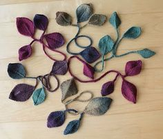 Knit Leaf bookmarks-good way to use up those little bits of leftover yarn. Free pattern on Ravelry for the leaf.