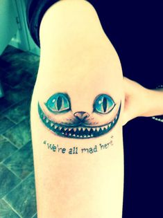 This is my Cheshire Cat tattoo, which was done by Lines of Fire tattoo studio in Clare, Australia.  Alice in Wonderland is one of my favourite books, and the line 'we're all mad here' is one of my favourite quotes. It's always stuck with me, and it just fits well with my mentality. :)