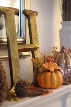 Fall Mantel - Display a large family initial with traditional decor.