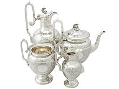 Sterling Silver Four Piece Tea and Coffee Service - Antique Victorian  SKU: A3370 Price  GBP £4,950.00  http://www.acsilver.co.uk/shop/pc/Sterling-Silver-Four-Piece-Tea-and-Coffee-Service-Antique-Victorian-97p3781.htm#.Vjnw8is8rfc