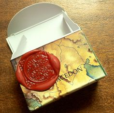 1x1.5x2 inch tea bag box adorned with map paper & sealing wax