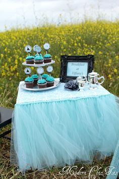 Breakfast at Tiffany's party.  LOVE, LOVE, LOVE!!!!  @Caitlin Burton Burton Burton Burton Burton Giles Barnes aqua frilly tutu table skirt    ideas & inspiration curated and collected by @party-party-party-party-party-party Design Shop