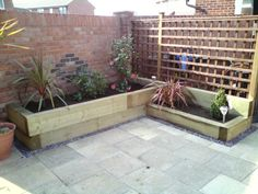 wooden raised flower beds and gravel