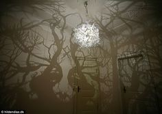 Magical: The artwork creates a network of shadowy roots and gnarled trees using light