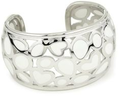 """Roberto Coin """"Fifth Season"""" White Enamel Silver Mauresque Bangle Bracelet Roberto Coin. $930.00. Created by Italian designer Roberto Coin for the Fifth Season. Made in Italy. Intricate Mauresque design adds a splash of contemporary fashion. Diameter is 50x60mm"""