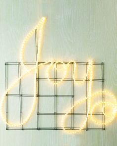 Another unique Christmas light idea from Martha Stewart. Write a message in lights to share with all who pass by. Here they used LED rope lighting. The rope lighting is secured to a grid of wire wreath forms with heavy-duty cable ties. Indoor Christmas Lights, Christmas Lights Outside, Outdoor Christmas Decorations, Holiday Lights, Light Decorations, Christmas Crafts, Christmas Ideas, Christmas Stage Design, Xmas Lights