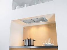 Remodeling Ceilingmounted Recessed Kitchen Vents Remodelista With Its Price Including External Blower Is In The Ballpark For Most Ceiling Kitchen Extractor Fan, Kitchen Exhaust, Kitchen Vent, Hidden Kitchen, Kitchen Hoods, Kitchen Units, Kitchen Ideas, Kitchen Appliances, Integrated Cooker Hoods