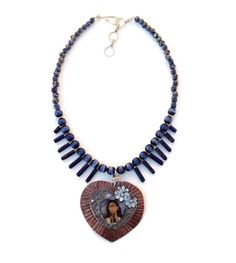 Frida Kahlo Mixed Metal Heart Pedant on a Blue Necklace. Handmade Artisan Jewelry, Upcycled, Recycled, The Lost Earring Project by WinkArtisans Handmade Necklaces, Handmade Jewelry, Unique Jewelry, Blue Necklace, Beaded Necklace, Mixed Metals, Artisan Jewelry, Washer Necklace, Lost