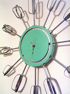 clock with hand mixer beaters.