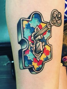 """Autism puzzle piece tattoo symbolizing the idea of """"unlocking the potential"""" of these special children"""