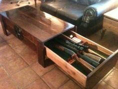 Gun storage under the coffee table. Clever, looks good and is practical(ish)