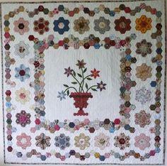 Myndaniðurstöður Google fyrir http://www.sewnaive.com/product_images/uploaded_images/jans_hexagon_quilt.jpg
