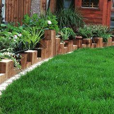 Vertical sleeper planting bed edging. #Tomoco #landscaping