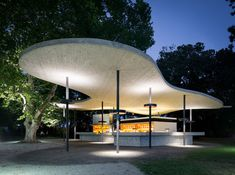 "With a roof draped ""like a leaf between trees"", the ""Wolke 7"" (Cloud 7) structure nestles naturally into the historic park landscape. On the path between.."