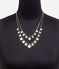 Sliver   http://www.express.com/clothing/twotorow+floating+squares+necklace/pro/0261364/cat570006
