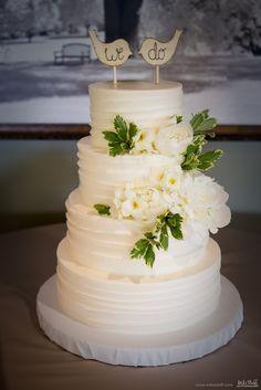 Simple buttercream wedding cake with white flowers and wooden bird topper #wedding #cake #Michiganwedding #Chicagowedding #MikeStaffProductions #wedding #reception #weddingphotography #weddingdj #weddingvideography #wedding #photos #wedding #pictures #ideas #planning #DJ #photography