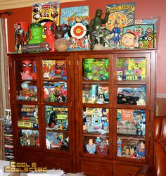 """""""cool and collected's vintage toy collection."""" I love how the glass doors on these shelves to be able to see everything but keep most of the dust off. What a cool look."""