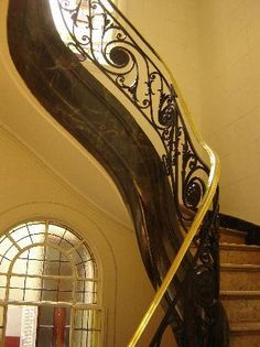 Art Nouveau- Staircase that curls into the environment, playing with perception and sensibility  visual