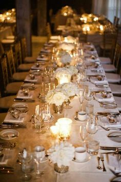 white flowers and candles centerpieces