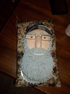 Uncle si (Duck dynasty) cake. I made for my boys birthday. followed instructions  by clumsycrafter.com on how to make a duck dynasty cake, but did my own twist on decorating the face.