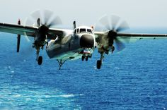 ARABIAN GULF (Aug. 7, 2014) A Grumman C-2A Greyhound assigned to the Rawhides of Fleet Logistics Support Squadron (VRC) 40 prepares to land on the flight deck of the aircraft carrier USS George H.W. Bush (CVN 77). George H.W. Bush is supporting maritime security operations and theater security cooperation efforts in the U.S. 5th Fleet area of responsibility. (U.S. Navy photo by Mass Communication Specialist 3rd Class Joshua Card/Released)