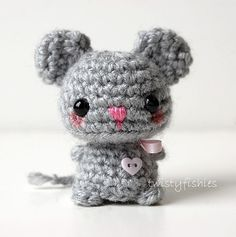 Baby Gray Mouse - Kawaii Mini Amigurumi Plush    This baby amigurumi mouse stands at just 2 1/4 inches tall, by 1 3/4 inches at her widest. She is tightly crocheted in creamy gray acrylic yarn. She has black child safe eyes, and wears a pink ribbon tied around her neck in a bow. There is a tiny pink heart button hand-stitched to her chest. <3    Her nose and mouth are hand-stitched in pink. Stuffed with non-allergenic Poly-fil, and made of all new materials in a smoke free home. ...