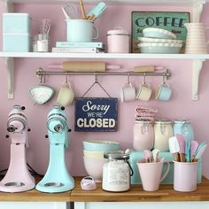 Perfect retro pastel kitchen with pink smeg and kitchen aid!