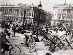 Sniper fire sends French citizens sprawling or fleeing in the Place de la Concorde, 1944