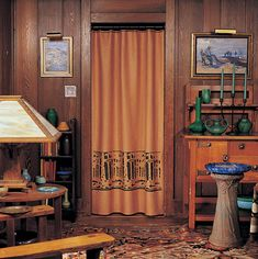 Stenciled portieres (doorway curtains) harmonize with Arts & Crafts woodwork and cut down on drafts.