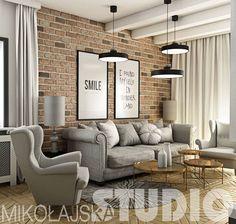 Piękny projekt salonu ze ścianą z czerwonej cegły