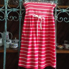 """MINI BEACH DRESS BY JUICY COUTURE Details: Coral and White Stripes with elastic at top and ties at waist area with two grommets Material:  82% Cotton, 18% Poly (Terry type feel) Size S Measurements: 25.5"""" from shoulder to bottom of hem, 12"""" at unstretched elastic waist  Gently worn Juicy Couture Dresses Mini"""