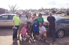Seniors Calvin Lynch, second from left, and Nick Streicher, kneeling at right, with a family they helped on an impromptu relief trip to Moore, Oklahoma, over the Memorial Day weekend. More about their trip on STATEside, ISU's daily campus blog.