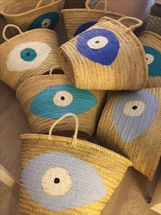 handpainted evil eye straw baskets by cotton princewww.cottonprince.gr