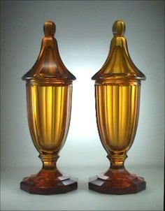 Pair MOSER Art Deco Amber Glass Covered Jars. Eight-sided panel cut heavy amber glass