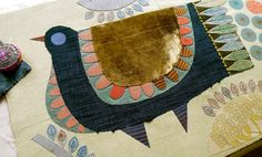 Applique stage of Pigeon embroidery