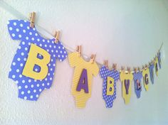 Onesie BABY GIRL Baby Shower Banner: Purple and Yellow Baby Shower Decoration via Etsy