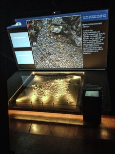 """Tuning the hotspots on the model for the interaction, using test images on the 4m wide screen on top. Interactive exhibit for the """"MUSEUM OF THE CITY OF ATHENS VOUROS–EUTAXIAS FOUNDATION"""" by archiplus architects 
