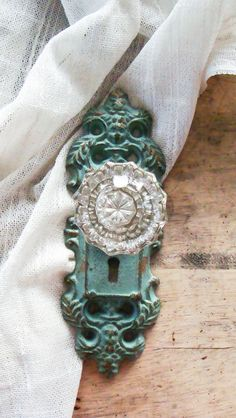 I love the shape of the door knob holder and the antique look with the glam crystal knob. I love the aqua color. Aqua Door, Turquoise Door, Antique Door Knobs, Antique Doors, Vintage Doors, Old Doors, Antique Hardware, Curtain Holder, Curtain Tie Backs