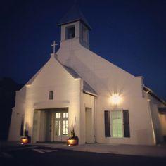 Smooth stucco siding, dark wood accents, simple. Church in Celebration FL