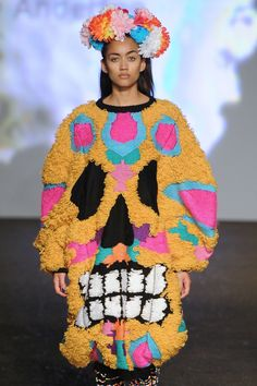 Kirsty Anderton showed a Mexican treat at the university of Middlesex's final graduate show. Piñata-like textiles, day of the dead inspired imagery, floral crowns and a candy skull palette brought this punchy look to life.